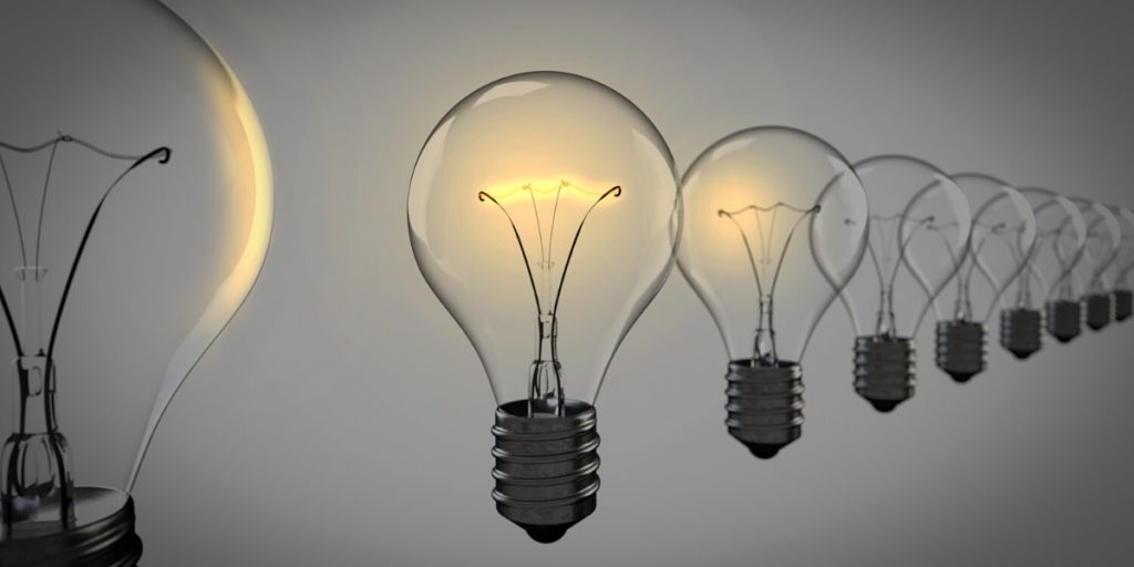 Image of a lightbulb being lit, representing the success of candidate finding his dream job with the help of CareerArc outplacement.
