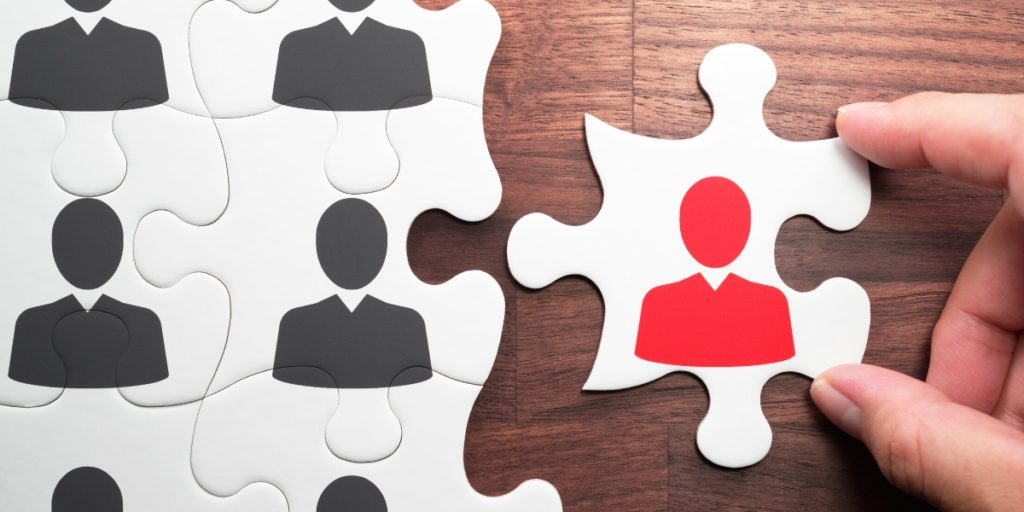 View of puzzle pieces with employees on them, representing a prepared workforce who has the answer to what is an outplacement consultant.