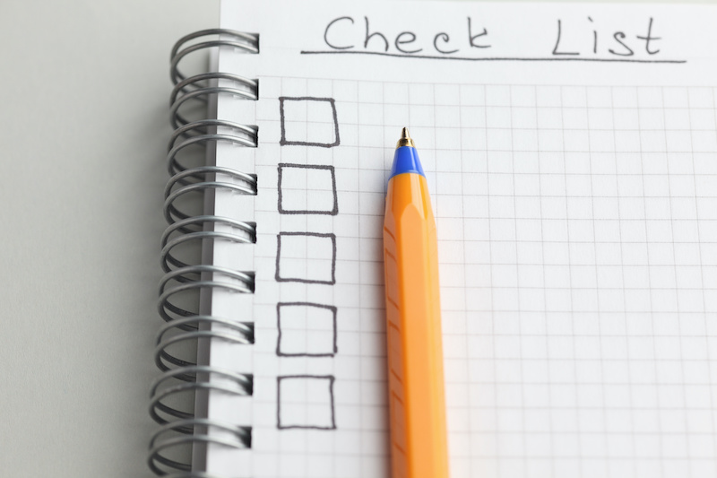 A handwritten checklist for noting what top outplacement services offer.